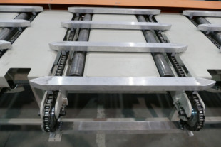 Side sweep chains with ending roller conveyor